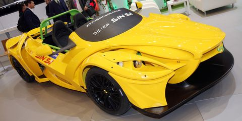Land vehicle, Vehicle, Car, Auto show, Yellow, Sports car, Automotive design, Motor vehicle, Supercar, Custom car,