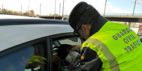 Motor vehicle, Vehicle, Mode of transport, Police, Car, Vehicle door, Official, Automotive window part, Police officer, Personal protective equipment,