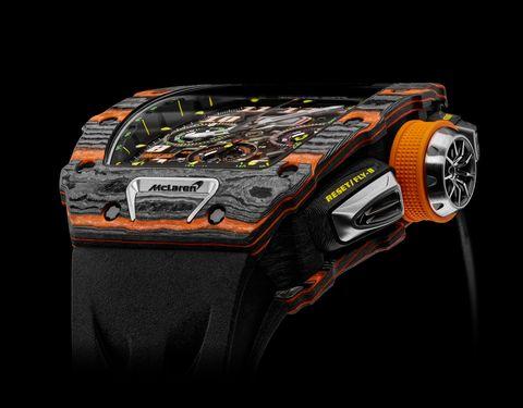 Electronics, Orange, Vehicle, Watch, Technology, Automotive design, Font, Auto part, Car,