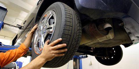 Tire, Automotive tire, Automobile repair shop, Auto part, Wheel, Alloy wheel, Motor vehicle, Vehicle, Automotive wheel system, Car,