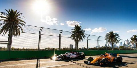 Sky, Tree, Vehicle, Tennis court, Sport venue, Palm tree, Cloud, Sunlight, Car, Race track,