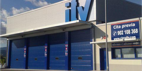 Blue, Real estate, Commercial building, Signage, Electric blue, Majorelle blue, Composite material, Gas, Sign, Concrete,
