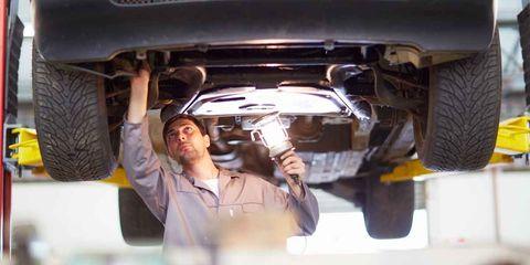 Automobile repair shop, Auto part, Auto mechanic, Vehicle, Car, Automotive exterior, Muffler, Suspension, Suspension part, Panel beater,
