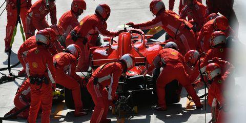Pit stop, Race track, Sport venue, Red, Team, Vehicle, Race car, Motorsport, Formula one, Crew,