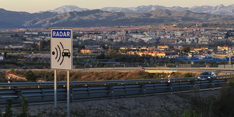 Freeway, Sky, Road, Transport, Traffic sign, Highway, Signage, Sign, Infrastructure, Mountain,