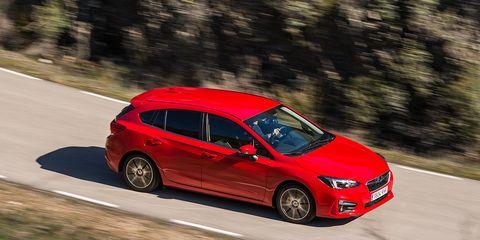 Land vehicle, Vehicle, Car, Red, Full-size car, Mid-size car, Automotive design, Family car, Hatchback, Hot hatch,