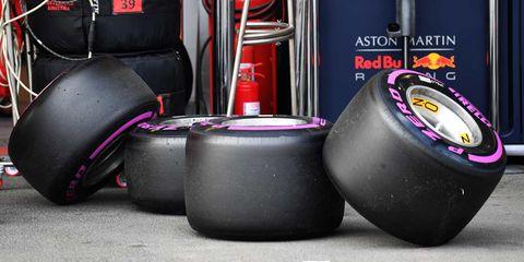 Tire, Automotive tire, Formula one tyres, Auto part, Wheel, Automotive wheel system, Rim, Purple, Synthetic rubber, Vehicle,