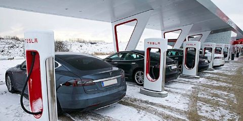 Vehicle, Tesla model s, Car, Transport, Parking, Tesla, Mode of transport, Automotive design, Family car, Electric car,