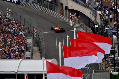 Formula one, Red, Crowd, Endurance racing (motorsport), Race track, Sport venue, Flag, Motorsport, Stadium, Vehicle,