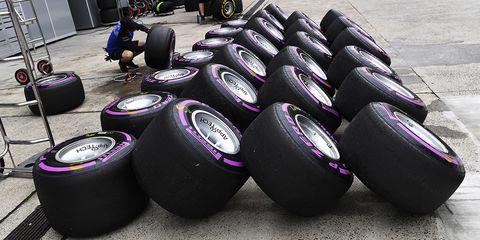Tire, Automotive tire, Formula one tyres, Auto part, Purple, Wheel, Synthetic rubber, Automotive wheel system, Motor vehicle, Rim,