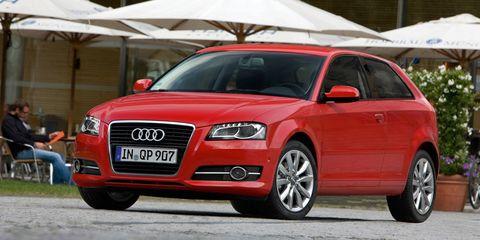 Tire, Automotive design, Vehicle, Red, Car, Vehicle registration plate, Alloy wheel, Grille, Hood, Rim,