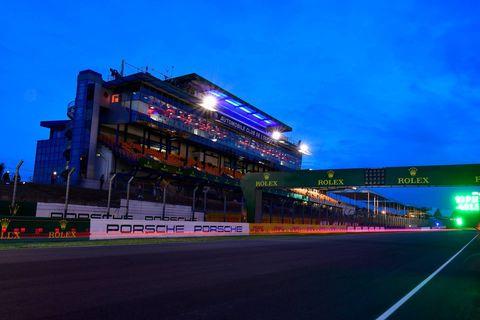 Architecture, Night, Light, Landmark, Sky, Sport venue, Metropolitan area, Race track, Lighting, Urban area,