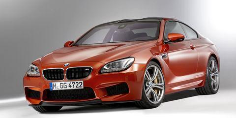 Automotive design, Vehicle, Hood, Grille, Car, Red, Automotive lighting, Rim, Fender, Alloy wheel,