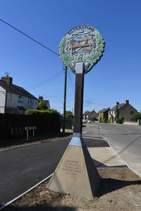 Sky, Tree, Sculpture, Road, Architecture, Road surface, Signage, Art, Street, Street light,