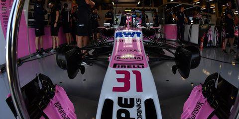 Pink, Race car, Vehicle, Auto show, Formula one car, Car, Open-wheel car,