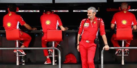 Formula one, Red, Sport venue, Uniform, Pit stop, Race car, Team, Motorsport, Car, Sports,