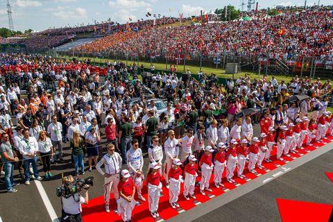 People, Crowd, Event, Parade, Public event, Festival, Marching, Sport venue, Audience, Stadium,