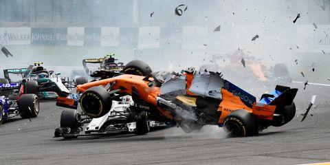 Vehicle, Formula libre, Formula one tyres, Formula one, Automotive tire, Motorsport, Tire, Race car, Formula one car, Race track,