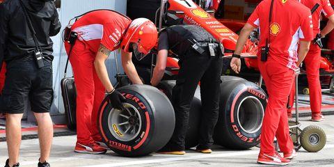 Tire, Automotive tire, Formula one tyres, Race track, Pit stop, Motorsport, Race car, Automotive wheel system, Vehicle, Auto part,