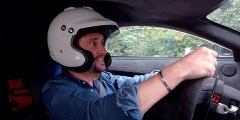 Helmet, Motorcycle helmet, Personal protective equipment, Headgear, Vehicle, Vehicle door, Car, Driving,