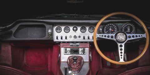 Land vehicle, Vehicle, Car, Steering wheel, Center console, Steering part, Classic car, Coupé, Sedan,