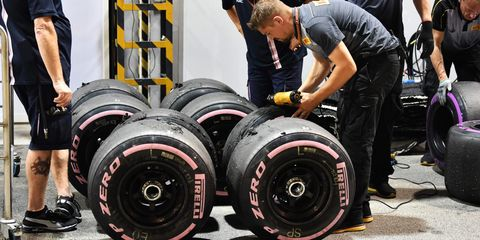 Tire, Automotive tire, Formula one tyres, Physical fitness, Weight training, Auto part, Automotive wheel system, Wheel, Rim, Exercise,