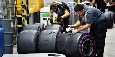 Tire, Automotive tire, Formula one tyres, Automotive wheel system, Auto part, Motor vehicle, Vehicle, Automotive design, Physical fitness, Wheel,