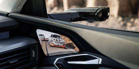 Land vehicle, Vehicle, Car, Automotive design, Personal luxury car, Luxury vehicle, Steering wheel, Vehicle door, Automotive mirror, Rear-view mirror,