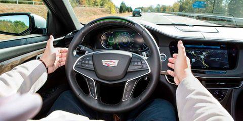Land vehicle, Vehicle, Car, Motor vehicle, Steering wheel, Steering part, Luxury vehicle, Automotive design, Center console, Driving,