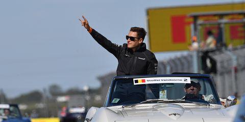 Vehicle, Eyewear, Sunglasses, Car, Racing, Automotive window part, Motorsport, Hood, Gesture, Autocross,