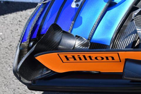 Vehicle, Car, Automotive design, Helmet, Electric blue, Personal protective equipment, Supercar, Sports car, Wheel,