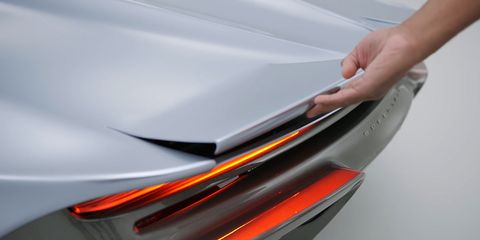 Automotive exterior, Automotive design, Hood, Vehicle door, Bumper, Vehicle, Orange, Car, Auto part, Personal luxury car,