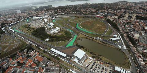 Sport venue, Aerial photography, Bird's-eye view, Stadium, Race track, Junction, Urban design, Arena, Urban area, Metropolitan area,