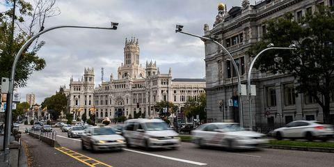 Landmark, City, Town, Building, Human settlement, Metropolis, Architecture, Traffic, Street, Vehicle,