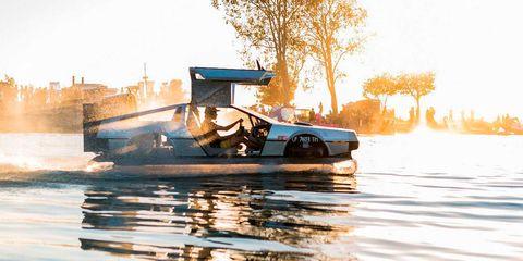 Water transportation, Vehicle, Waterway, Mode of transport, Boating, Boat, Automotive exterior, Automotive design, Car, Speedboat,