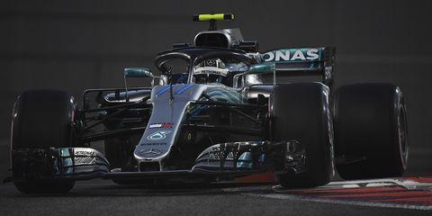 Formula one car, Formula one, Formula libre, Race car, Formula one tyres, Vehicle, Open-wheel car, Formula racing, Automotive tire, Tire,