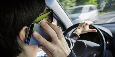 Driving, Vehicle door, Hand, Eyewear, Auto part, Glasses, Steering wheel, Windshield, Technology, Vehicle,