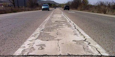Motor vehicle, Road, Road surface, Asphalt, Infrastructure, Automotive exterior, Line, Thoroughfare, Automotive tire, Lane,