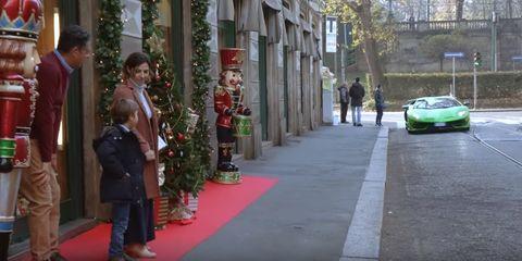 Red, Sidewalk, Luxury vehicle, Car, Vehicle, Pedestrian, Public space, Urban area, Human settlement, Snapshot,