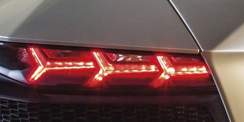 Automotive lighting, Vehicle, Light, Car, Automotive tail & brake light, Automotive design, Headlamp, Auto part, Automotive exterior, Mid-size car,