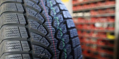 Tire, Tread, Automotive tire, Synthetic rubber, Auto part, Automotive wheel system, Close-up, Tire care, Natural rubber, Wheel,