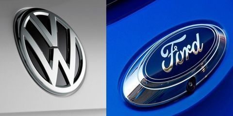 Land vehicle, Vehicle, Car, Logo, Trademark, Automotive design, Emblem, Electric blue, Mid-size car, Wheel,