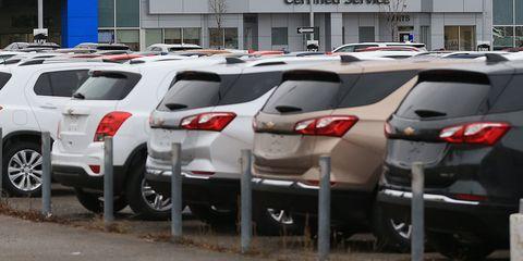Land vehicle, Vehicle, Car, Motor vehicle, Parking, Parking lot, Automotive design, Public space, Transport, Car dealership,