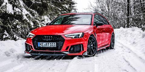 Land vehicle, Vehicle, Car, Audi, Automotive design, Motor vehicle, Snow, Audi rs 6, Sports car, Bumper,