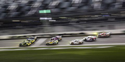Race track, Endurance racing (motorsport), Vehicle, Motorsport, Racing, Performance car, Sports car racing, Auto racing, Car, Yellow,
