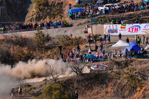 World rally championship, Vehicle, Off-roading, Racing, Tree, Rallying, Flip (acrobatic), Extreme sport, Crowd, Motorsport,