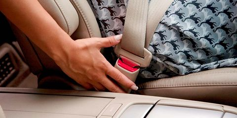 Red, Product, Beige, Skin, Seat belt, Car seat, Vehicle door, Auto part, Nail, Hand,