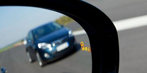 Motor vehicle, Automotive mirror, Mode of transport, Automotive design, Transport, Automotive exterior, Car, Automotive lighting, Vehicle door, Rear-view mirror,