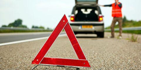 Motor vehicle, Traffic sign, Road, Asphalt, Lane, Mode of transport, Road surface, Transport, Vehicle, Sign,