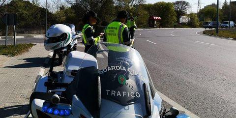 Motor vehicle, Vehicle, Motorcycle helmet, Helmet, Automotive exterior, Motorcycling, Asphalt, Road, Car, Lane,